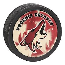 Phoenix Coyotes hockey puck and complete schedule